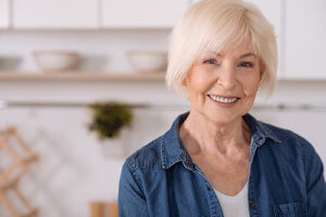 a woman is pleased with senior living amenities in blue ridge